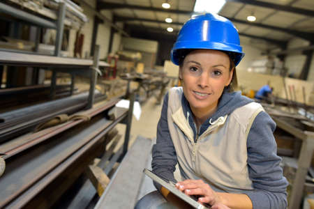 steel worker: Woman engineer in steel plant checking production