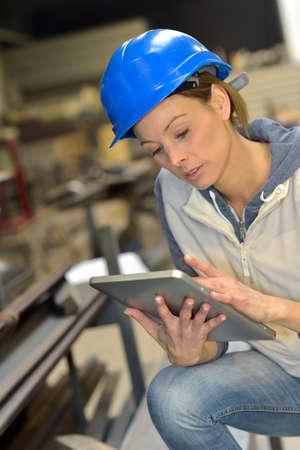 woman engineer: Woman engineer in steel plant using tablet