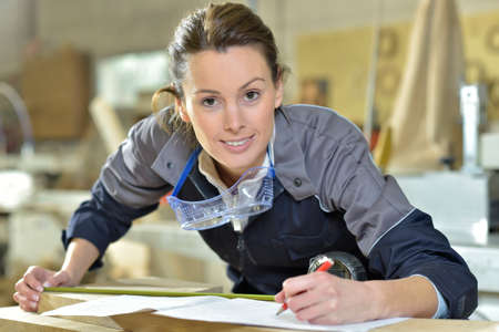 craftsmanship: Young woman in carpentry professional training