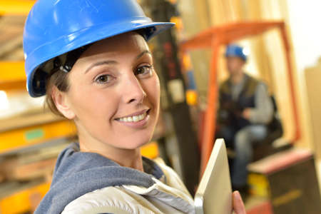 overseer: Smiling woman working in warehouse