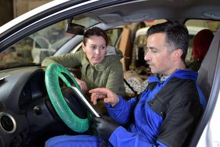 mechanician: Mechanic doing technical inspection on individual car