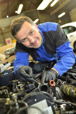 repair shop: Technician working in auto repair shop
