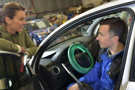 mot: Mechanic doing technical inspection on individual car