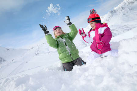 snow flakes: Kids having fun playing in the snow