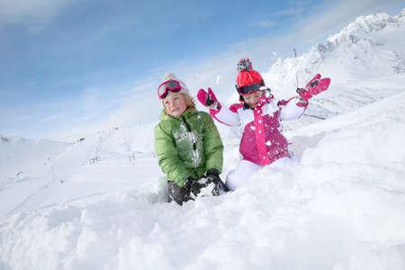 kids having fun: Kids having fun playing in the snow