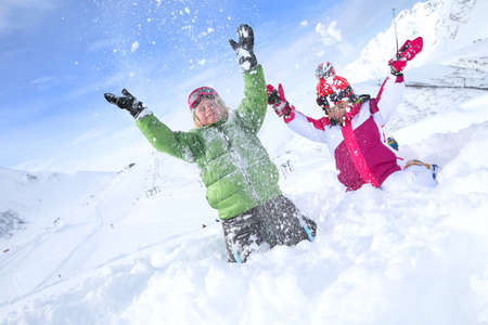Kids having fun playing in the snow