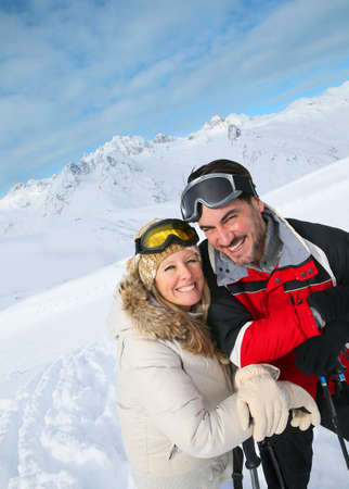 Couple of skiers enjoying winter vacation photo