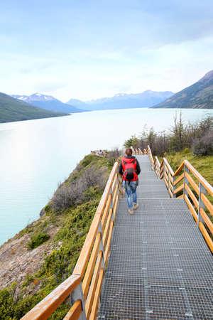 argentino: Tourist walking on Perito Moreno footbridge by Argentino lake