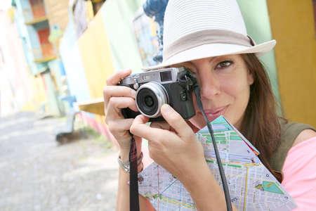 la boca: Female Tourist taking picture in La Boca neighborhood, Buenos Aires