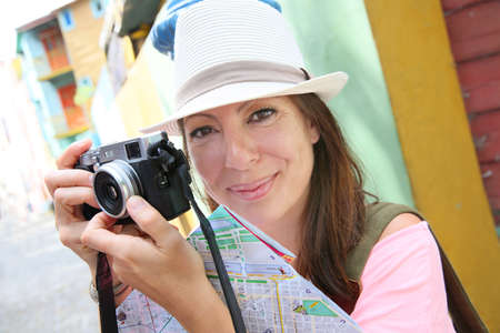 Woman Tourist taking picture in La Boca neighborhood, Buenos Aires