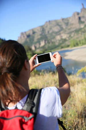 Backpacker taking picture of Limay river, Patagonia photo