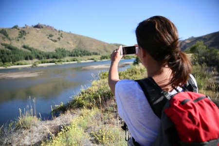 backpacker: Backpacker taking picture of Limay river, Patagonia