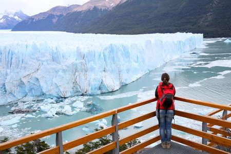 moreno glacier: Tourist standing on footbridge in front of Perito Moreno Glacier Stock Photo