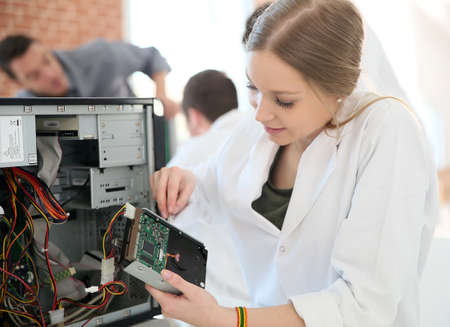 Student girl in technology fixing computer hard drive Standard-Bild
