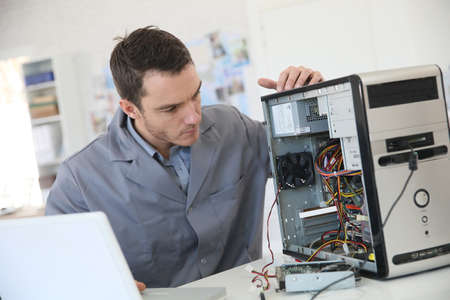 installation: Technician fixing computer hardware Stock Photo