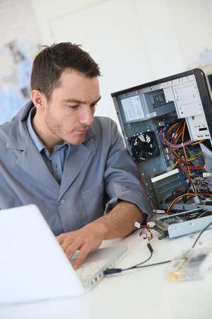 computer engineer: Technician fixing computer hardware Stock Photo