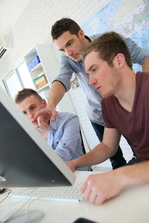 students studying: Students in digital design training course with instructor