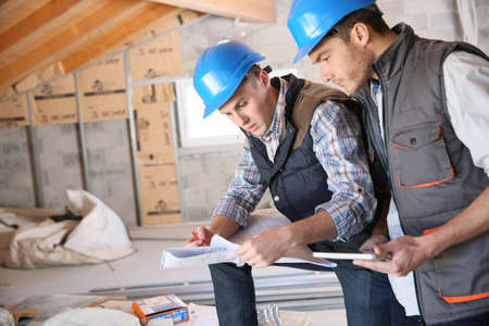 engineering plans: Construction engineers meeting on site Stock Photo