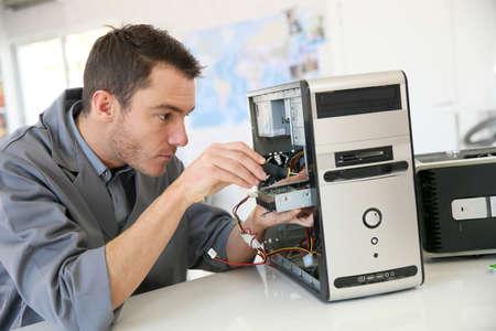 Technician fixing computer hardware Foto de archivo