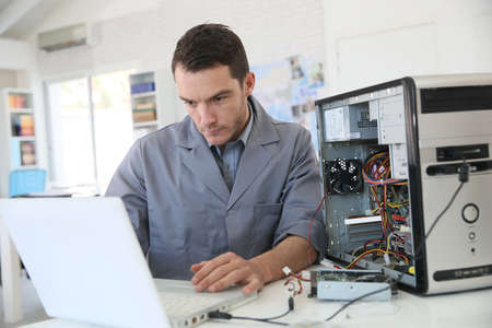 Technician fixing computer hardware Stock Photo