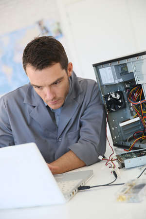 hardware: Technician fixing computer hardware Stock Photo
