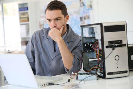 Technician fixing computer hardware Archivio Fotografico