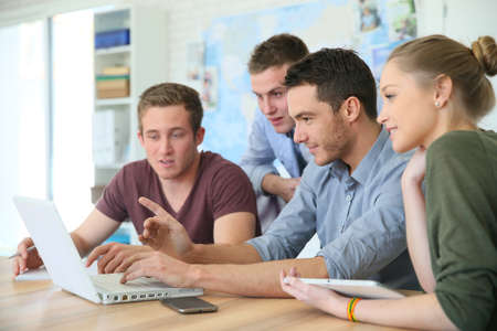 Group of young people in business training Standard-Bild