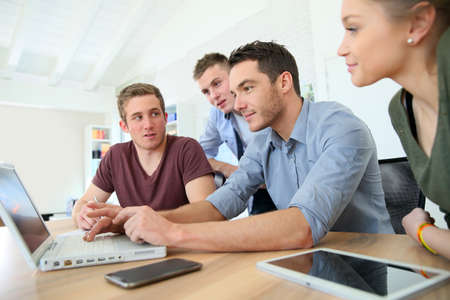 team mate: Group of young people in business training Stock Photo
