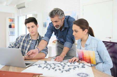 the old architecture: Teacher with students in architecture school