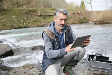 pollution water: Biologist testing quality of natural water Stock Photo