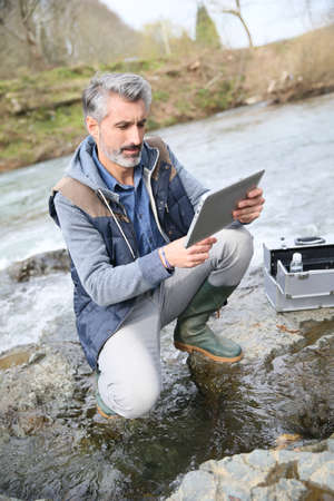 biologist: Biologist testing quality of natural water Stock Photo