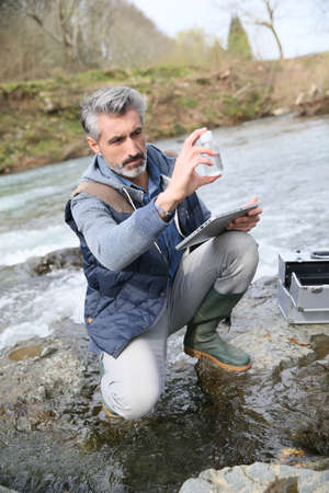 water pollution: Biologist testing quality of natural water Stock Photo