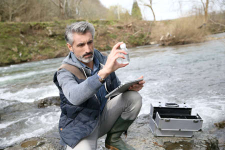 Biologist testing quality of natural water Stock Photo