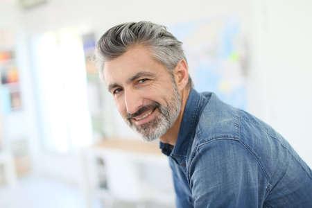 old man beard: Portrait of smiling mature teacher in class