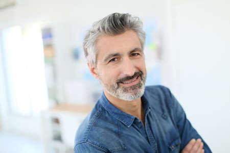 business shirt: Portrait of smiling mature teacher in class