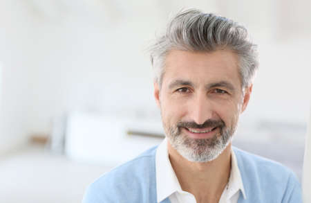 grey hair: Portrait of handsome mature man with grey hair