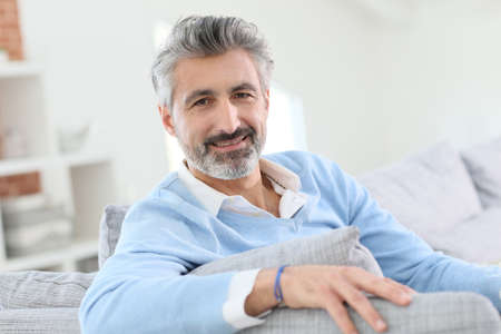 old man beard: 45-year-old man relaxing in sofa at home