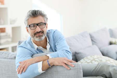 grey hair: Smiling mature man with grey hair wearing eyeglasses