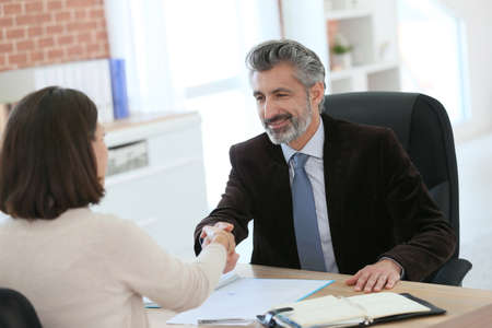 customer client: Attorney shaking hand to client after meeting Stock Photo