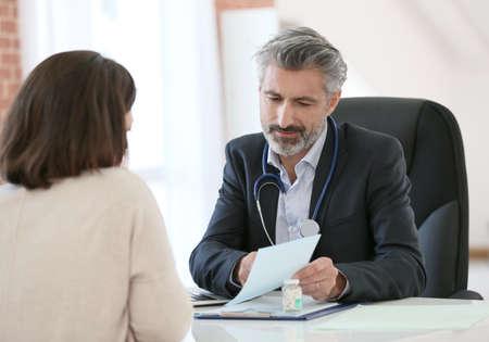 medecine: Doctor giving prescription to patient Stock Photo