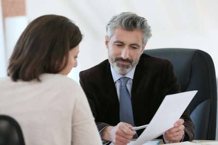 lawyer meeting: Attorney meeting client in office