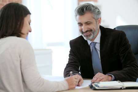 lawyer meeting: Attorney meeting client in office for signature Stock Photo