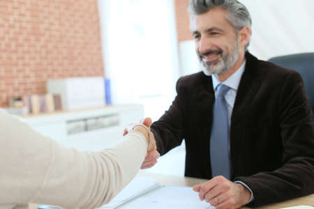 conclusion: Attorney shaking hand to client after meeting Stock Photo
