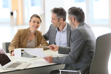 construction project: Mature couple meeting architect for construction project Stock Photo