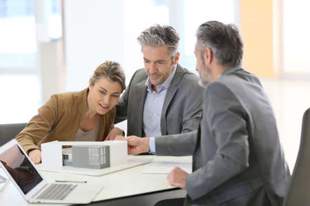 architect office: Mature couple meeting architect for construction project Stock Photo