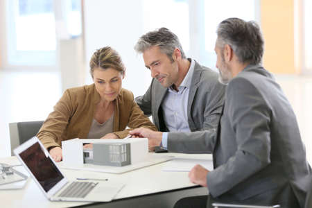 architect: Mature couple meeting architect for construction project Stock Photo
