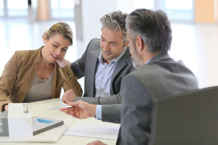 financial planner: Mature couple meeting architect for construction project Stock Photo
