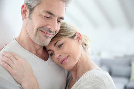 Mature couple embracing with love and tenderness photo