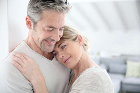 tenderness: Mature couple embracing with love and tenderness
