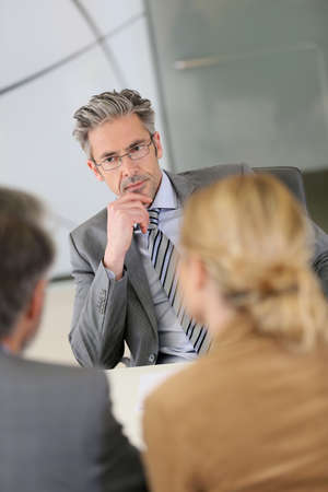financial planner: Consultant listening to clients in meeting